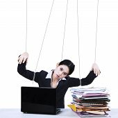 pic of obey  - Portrait of businesswoman working while controlled by using strings - JPG