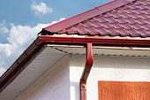 image of downspouts  - House roof gutters and downspout on the corner of a house - JPG
