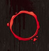 stock photo of bloody  - Bloody round frame on black wood texture background - JPG