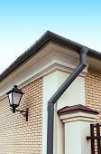 stock photo of gutter  - Newly installed modern rain gutter and drainpipe - JPG