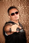 image of gangster necklace  - Hispanic Cop Pointing Gun at Camera Gangster Style - JPG