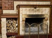 pic of cozy hearth  - Dirty empty fireplace with firewood - JPG