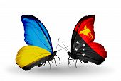 picture of papua new guinea  - Two butterflies with flags on wings as symbol of relations Ukraine and Papua New Guinea - JPG