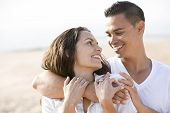 Close Up Of Affectionate Hispanic Couple On Beach