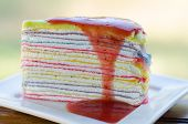 image of crepes  - crepe cake with strawberry sauce on white dish - JPG