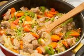image of stew  - Pork stew cooked in a frying pan - JPG