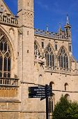 foto of church-of-england  - Cathedral church of St Peter and the Holy and Indivisible Trinity with a signpost in the foreground Gloucester Gloucestershire England UK Western Europe - JPG