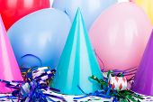 foto of birthday hat  - Birthday party hats with streamers and balloons - JPG