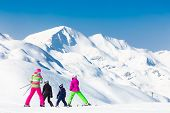 picture of family ski vacation  - Family on winter ski vacations in ski slopes in Alps - JPG