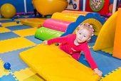 stock photo of playground  - Happy child girl on playground - JPG