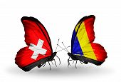 picture of chad  - Two butterflies with flags on wings as symbol of relations Switzerland and Chad Romania - JPG