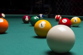 stock photo of pool ball  - Billiard balls in a pool table. billiard balls