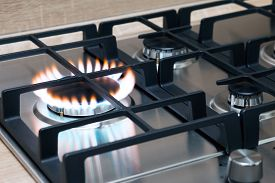 foto of grils  - Gas burning in the burner of gas oven - JPG