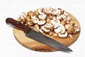 pic of crimini mushroom  - Chef cutting the mushrooms on a wooden board - JPG