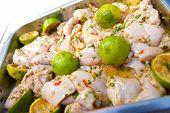 stock photo of marinade  - Close up raw chicken in lemon and chilli marinade - JPG