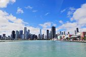 picture of skyscrapers  - Chicago city downtown urban skyline with skyscrapers over Lake Michigan with cloudy blue sky - JPG