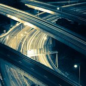 picture of hong kong bridge  - Abstract night view of highway interchange with moving cars - JPG