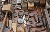 stock photo of flea  - hand drill old rusty padlocks and planers in the workshop of flea market - JPG