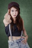 stock photo of middle finger  - Portrait of naughty girl with casual clothes showing middle finger gesture - JPG