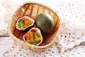 stock photo of passion fruit  - Passion fruits in basket on color wooden background - JPG