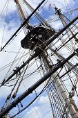 foto of sail ship  - Masts and sails of an old sailing ship in the port - JPG