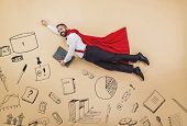 stock photo of cloak  - Manager in a superman pose wearing a red cloak - JPG