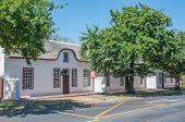 foto of tree lined street  - Historical buildings in oak tree lined streets - JPG
