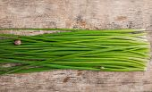 foto of chive  - bunch of fresh chives on a table - JPG
