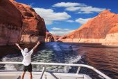 image of fascinator  - Man in  white shirt on the stern boat fascinated by nature - JPG
