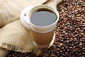 foto of sackcloth  - Paper cup of coffee with beans on sackcloth close up - JPG