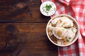 stock photo of liver fry  - Tasty dumplings with fried onion in brown bowl - JPG