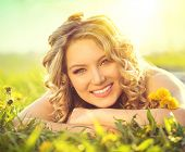 pic of lie  - Beautiful Young Woman lying on a field - JPG