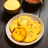 picture of corn  - Plate of arepas with Colombian hogao sauce  - JPG