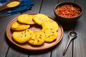 pic of corn  - Wooden plate of arepas with Colombian hogao sauce  - JPG