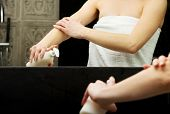stock photo of body-lotion  - Beautiful woman with body lotion in bathroom - JPG