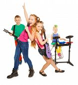 picture of singing  - Girl singing as vocalist and children playing on musical instruments together as rock group on white background - JPG