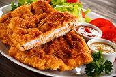 foto of pork chop  - Fried pork chops and vegetable salad  - JPG
