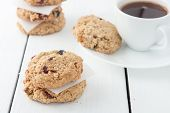 picture of baked raisin cookies  - homemade oatmeal raisin cookies on white background - JPG