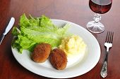 picture of pork cutlet  - roasted cutlets of pork with potato and wine - JPG