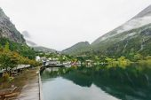 picture of fjord  - Pier and village in the Geiranger fjord Norway - JPG