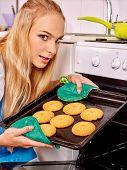 stock photo of bap  - Young woman baking  cookies at ktchen - JPG