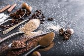 image of chocolate spoon  - Chocolate powder cocoa and coffee spoons on the table black - JPG