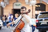image of cello  - The guy who plays the cello in the street in the summer - JPG