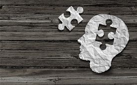 picture of headings  - Mental health symbol Puzzle and head brain concept as a human face profile made from crumpled white paper with a jigsaw piece cut out on a rustic old double page spread horizontal wood background - JPG