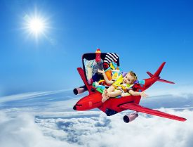 stock photo of packing  - Airplane Travel Baby Kid Packed Suitcase Child Flying inside Luggage Plane to Holiday Vacation over Blue Sky - JPG