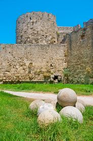 picture of cannon-ball  - Canon balls in the moat of medieval fortress - JPG