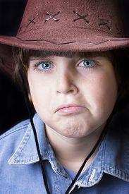 foto of freckle face  - Cute freckle faced boy wearing a cowboy hat - JPG