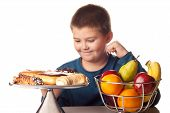 picture of high calorie foods  - boy wanting a high calorie snack over a healthy fruit - JPG
