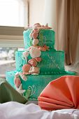 stock photo of three tier  - A blue beach themed wedding cake with three tiers - JPG
