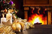 Постер, плакат: Christmas scene with fireplace and Christmas tree in the background